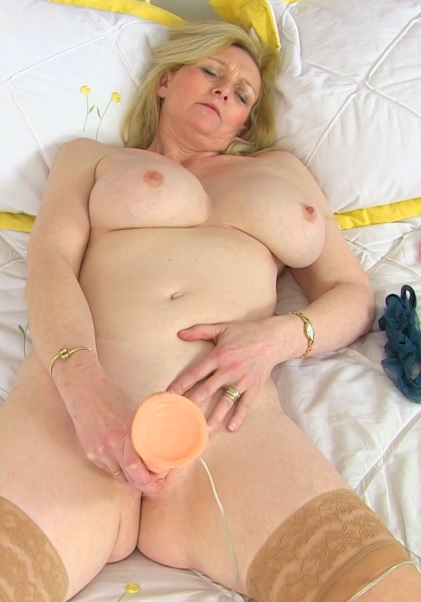 British housewife Suzie fooling around with her great boobs