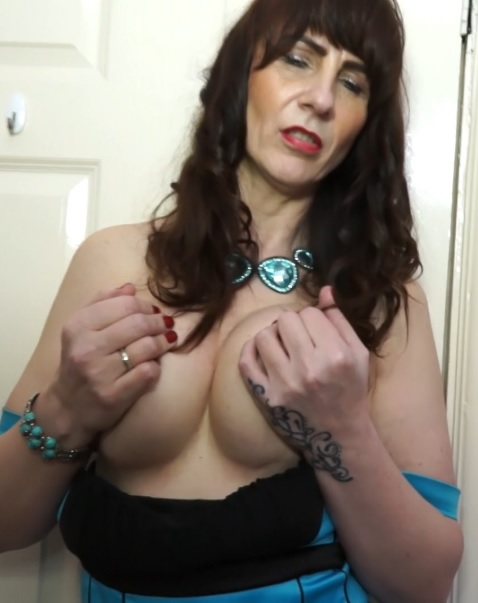 British housewife Toni Lace playing with her toys in bed