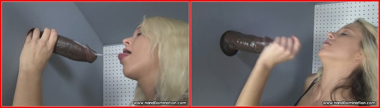 Very pretty blonde milking cock through a glory hole